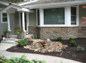Front close up view of a home with landscaping after property drainage installed