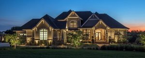Front of a home lit up at nigh | Moore's does outdoor and landscape lighting in Omaha