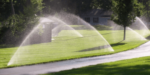 wide shot of a lawn irrigation system in use.
