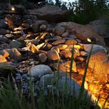 Landscape Lighting example, decorative rocks with lights. Moore's Landscape Lighting Services in Omaha.