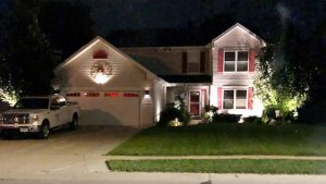 Front of house, with decorative outdoor lighting