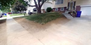 before sod has been applied to lawn being re-sloped.