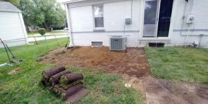 back of house property draining solutions with sod