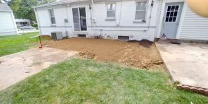 back yard of house showing property drainage solution being implemented
