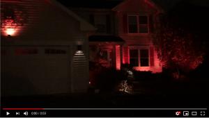 House lit with orange lighting for Haalloween