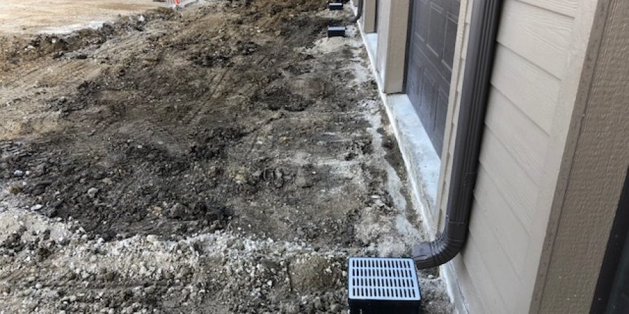 Downspout  Redirected to Underground Drainage Piping System