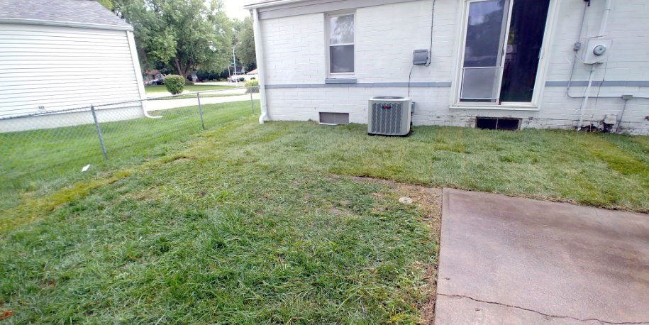 back yard of house with sod complete for property drainage